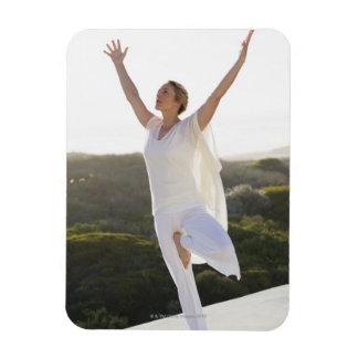 Mid adult woman practicing yoga 2 rectangular magnet