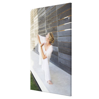 Mid adult woman practicing yoga canvas print