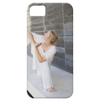 Mid adult woman practicing yoga iPhone 5 cases