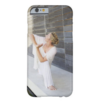 Mid adult woman practicing yoga barely there iPhone 6 case