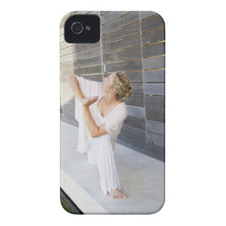 Mid adult woman practicing yoga Case-Mate iPhone 4 case
