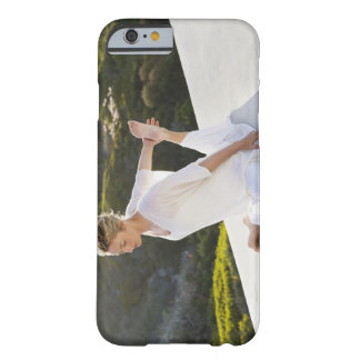 Mid adult woman practicing yoga exercise at barely there iPhone 6 case