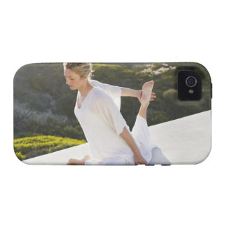 Mid adult woman practicing yoga exercise at iPhone 4/4S cover