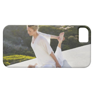 Mid adult woman practicing yoga exercise at iPhone 5 cases
