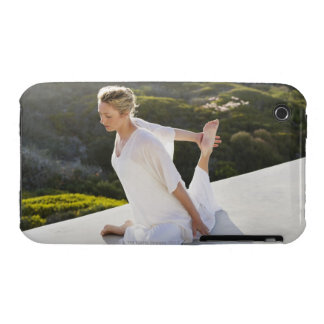 Mid adult woman practicing yoga exercise at iPhone 3 case
