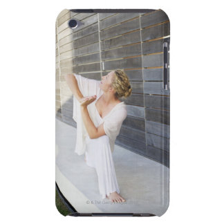 Mid adult woman practicing yoga iPod touch case