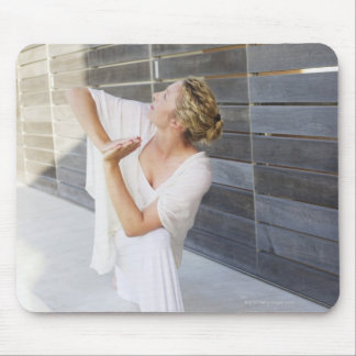 Mid adult woman practicing yoga mouse pad