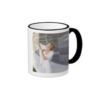 Mid adult woman practicing yoga ringer coffee mug