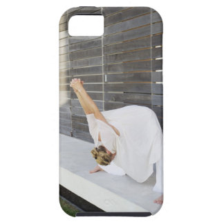 Mid adult woman stretching her arms iPhone 5 cover