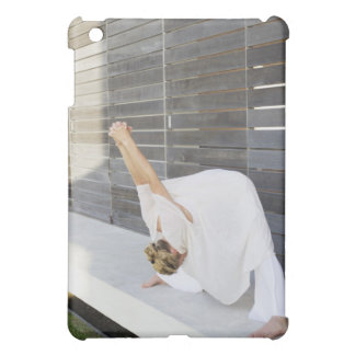 Mid adult woman stretching her arms iPad mini case