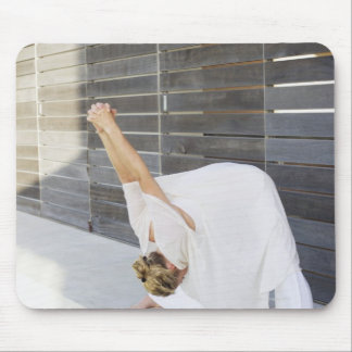 Mid adult woman stretching her arms mouse pad