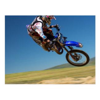 Mid air stunt on a motor bike postcard