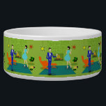 """Mid Century Modern Couple Ceramic Pet Bowl<br><div class=""""desc"""">This Mid Century Modern Couple Ceramic Pet Bowl looks like a scene out of a romantic comedy. The 1960&#39;s style, minimalist art design features an attractive cartoon couple enjoying a romantic evening at home. The sophisticated room prominently features a green stone wall with a roaring fire in the fireplace. The...</div>"""