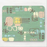 """Mid Century Modern Graphic Design Mousepad<br><div class=""""desc"""">Jeepers! If you&#39;re a fan of mid century modern style and books, you&#39;ll go positively ape for this Mid Century Modern Graphic Design Mousepad. The design features a replica of a vintage fabric with cool graphics. The background is jade green with kitschy designs in ecru, brown, yellow, blue and pink....</div>"""