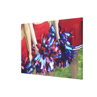 Mid Section View of Three Cheerleaders Canvas Print