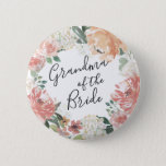 "Midsummer Floral Grandma of the Bride Pinback Button<br><div class=""desc"">Identify the key players at your bridal shower with our elegant,  sweetly chic floral buttons. Button features a watercolor floral wreath of peachy pink peonies,  white hydrangea flowers and botanical greenery with &quot;grandma of the bride&quot; inscribed inside in hand lettered script.</div>"