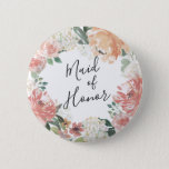 """Midsummer Floral Maid of Honor Pinback Button<br><div class=""""desc"""">Identify the key players at your bridal shower with our elegant,  sweetly chic floral buttons. Button features a watercolor floral wreath of peachy pink peonies,  white hydrangea flowers and botanical greenery with &quot;maid of honor&quot; inscribed inside in hand lettered script.</div>"""