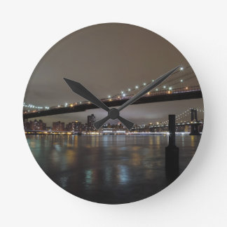 Midtown Manhattan at Night Round Wallclocks