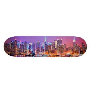 Midtown Manhattan at night with Empire Stae Skateboard Deck