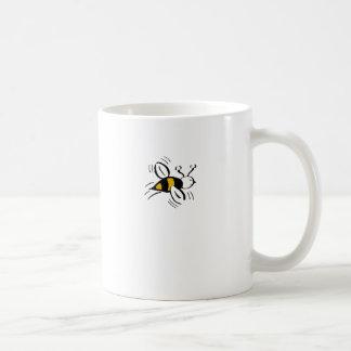 Miel libre de la abeja y mini negro taza de café