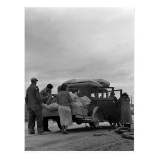 Migrants in 1936 with tire problems postcard