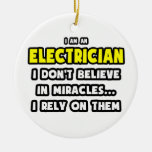Milagros y electricistas… divertidos ornamento de navidad