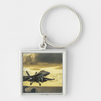 Military aircraft launching off aircraft carrier keychain