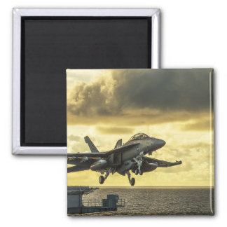 Military aircraft launching off aircraft carrier magnet