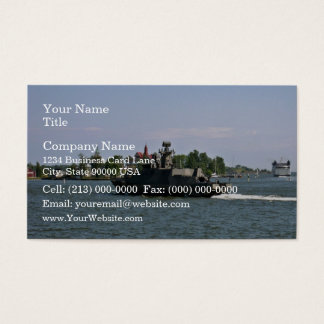 Military patrol boat against blue sky business card
