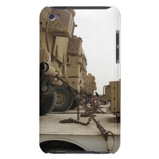 Military vehicles are locked down on semi truck iPod touch case
