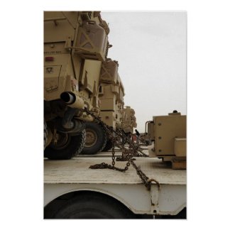 Military vehicles are locked down on semi truck poster