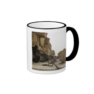 Military vehicles are locked down on semi truck ringer mug