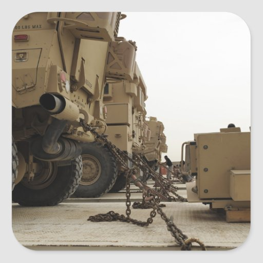 Military vehicles are locked down on semi truck square sticker
