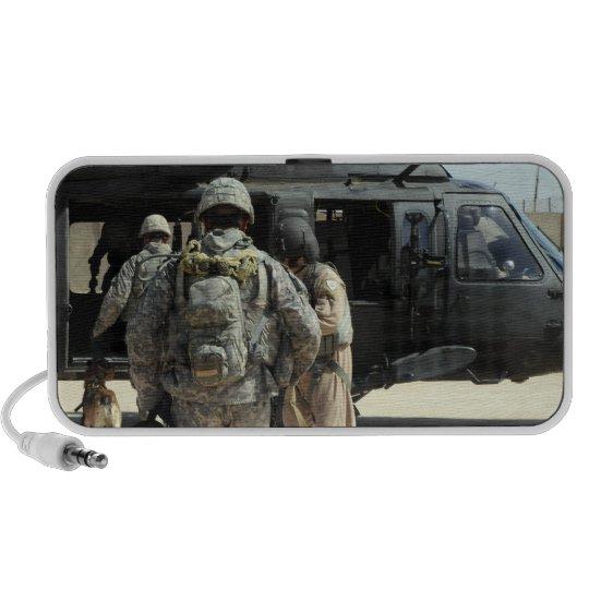 Military working dog handlers board a helicopte mini speaker