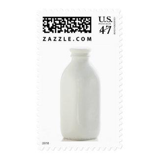 Milk bottle on white background postage stamp