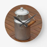 Milk can on a table round clock