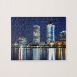 "Milwaukee Skyline at Night Jigsaw Puzzle<br><div class=""desc"">Long exposure of the Milwaukee Skyline at night,  with reflections off the water.</div>"