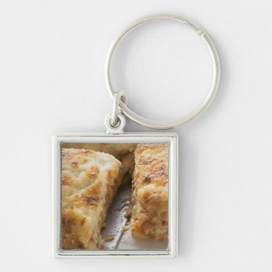 Mince lasagne, a portion cut keychain