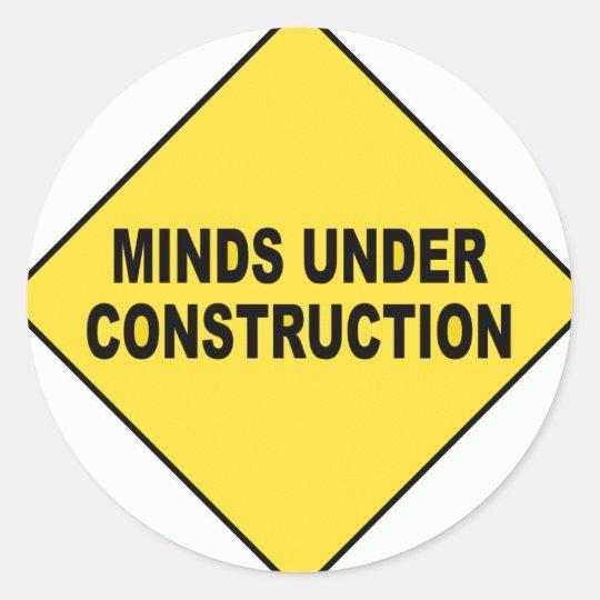 Minds under construction classic round sticker
