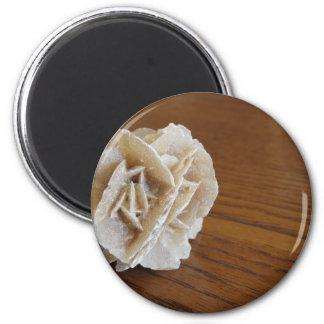 Mineral desert rose on wooden table magnet