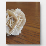 Mineral desert rose on wooden table plaque