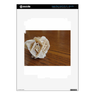 Mineral desert rose on wooden table skins for iPad 3