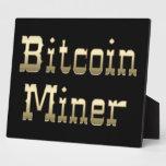 Minero de Bitcoin (en negro) Placa