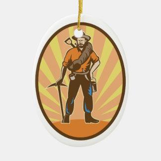 Minero de oro adorno navideño ovalado de cerámica