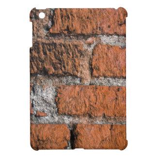 Mini caso del iPad rojo de la pared de ladrillo