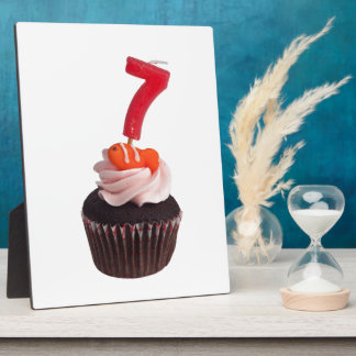 Mini cupcake with candle for seven year old plaque