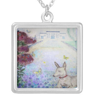 Mini-pincher in front of flaxfield square pendant necklace