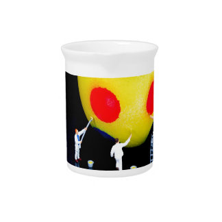 Miniature figurines painting yellow easter egg beverage pitcher