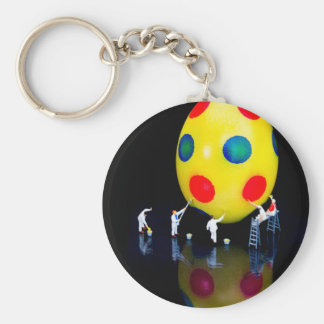 Miniature figurines painting yellow easter egg keychain