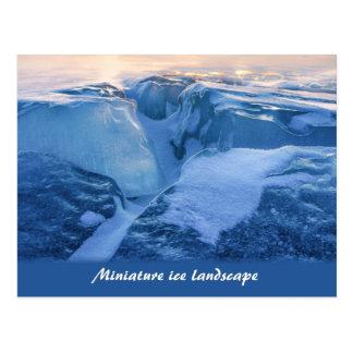 Miniature ice landscape and sunset postcard
